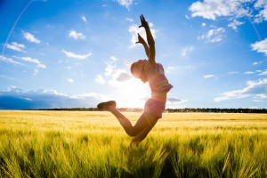 silhouette of jumping kid in the wheat field